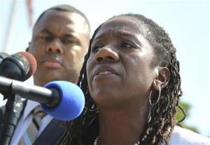 NAACP Legal Defense Fund Director Ryan Haygood (L) and NAACP Legal Defense and Educational Fund President Sherrilyn Ifill (R ) speak to reporters after the U.S. Supreme Court struck down part of a federal law designed to protect minority voters, at the court's building in Washington, June 25, 2013.